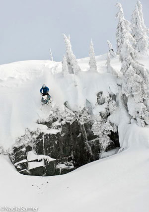 Stephanie Sweezey is a female snowmobiler and she goes big on her sled