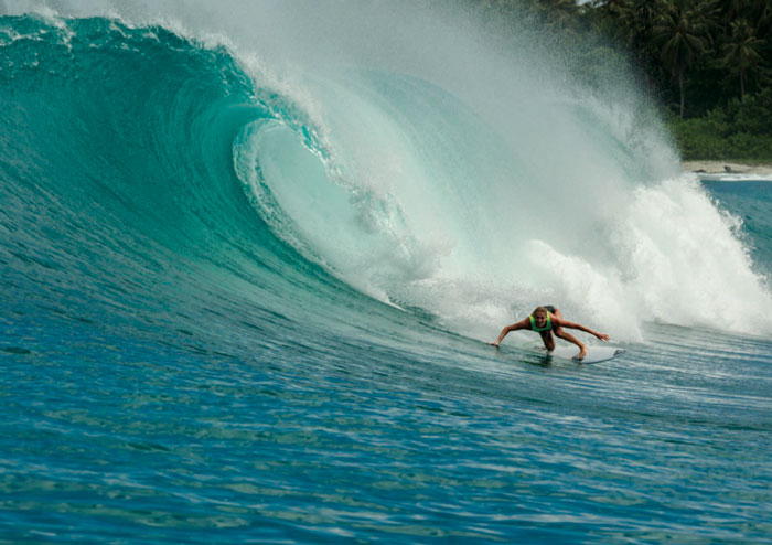 Stephanie Gilmore surfing a huge wave for Roxy