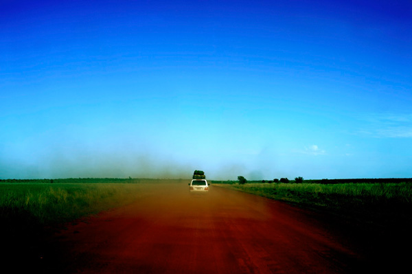 Road trip travel photo with sky and dirt road
