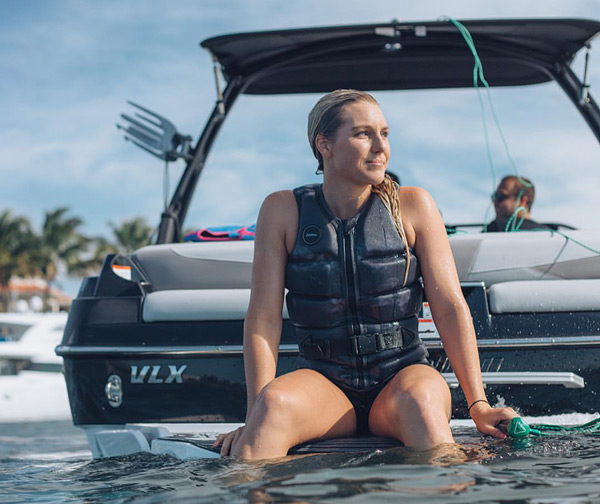 Pro wakeboarder Angelika Schriber resting on the boat