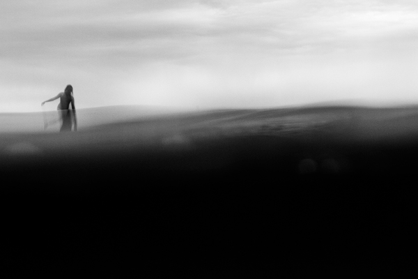Lone surfer in black and white. Surf photographer bt Fan Miller
