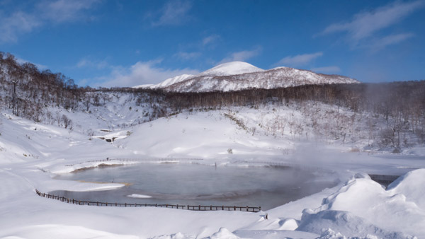 Natural onsen volcanic lake in Niseo Japan