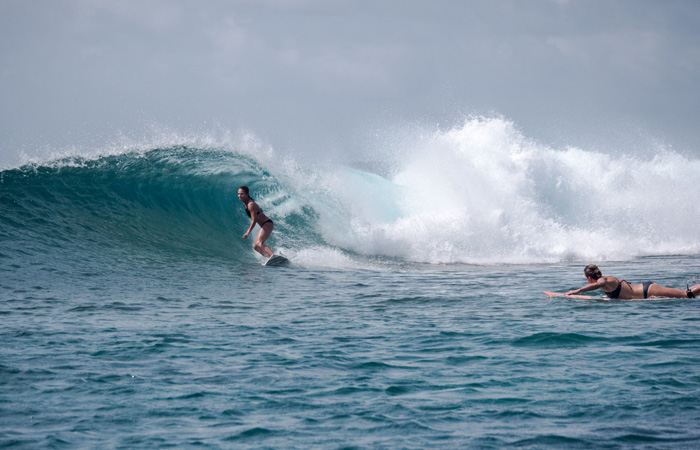Surfer Girl ripping in The Maldives