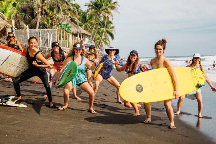Girl surfers on a all-girls surf camp