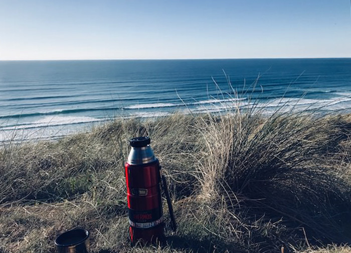 Hot water thermos on a winter surf trip