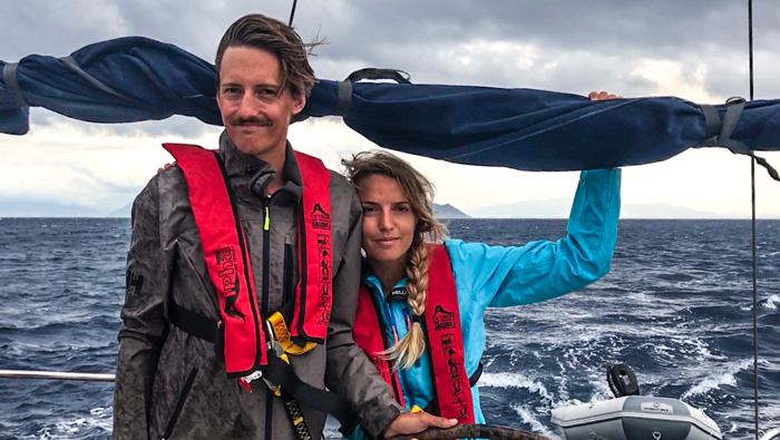 Young couple sailing around the world