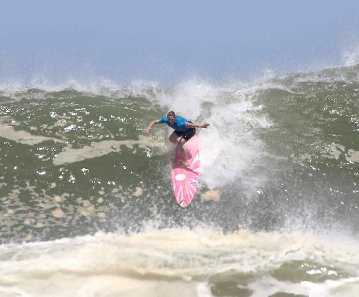 Woman surfing a big wave