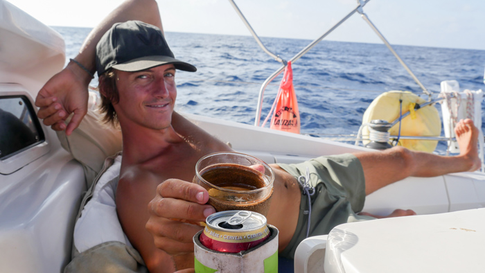 Sunset beer on sailing boat
