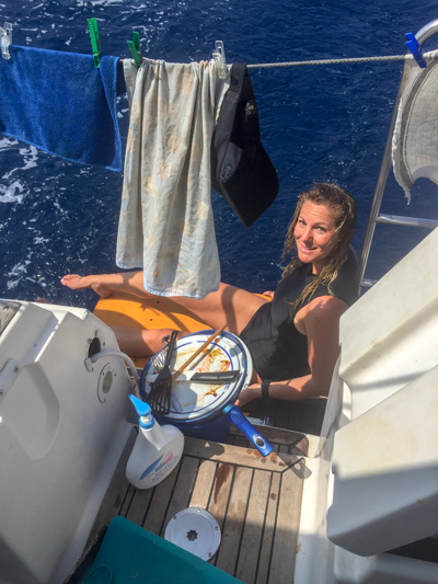 Doing the dishes on a sailboat at sea