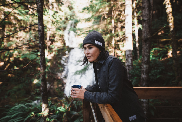 Girl with coffee at waterfall Canada