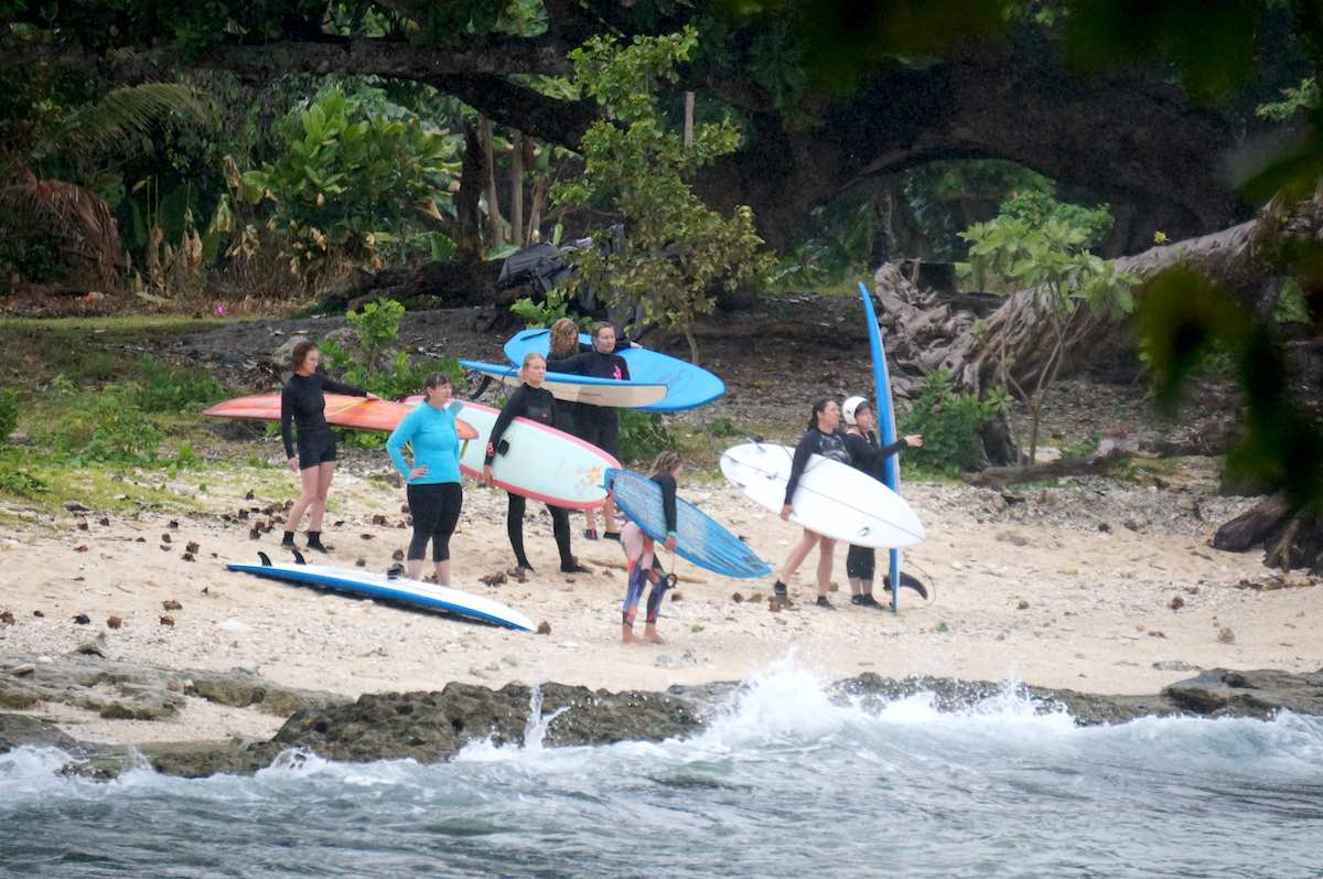 Middle aged surfers learn to surf on surf camp