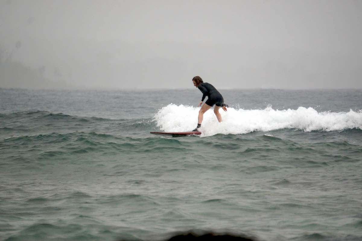 female middle aged surfers learn to surf