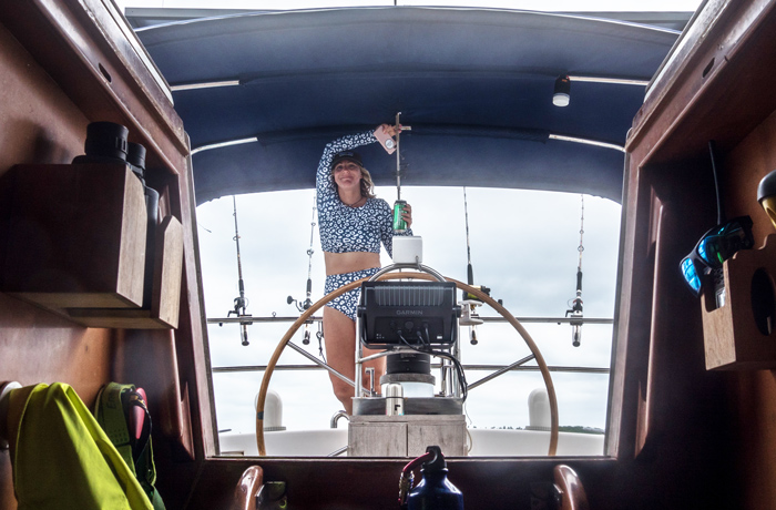 Girl on helm sailing boat