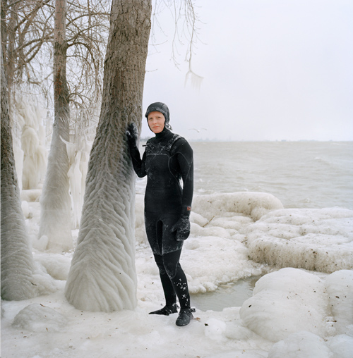 Woman surfer in snow