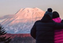 Romantic moment as couple looks at Mt. Yotei in Niseko ski resort Japan. Photo by Niseko Photography and Guiding