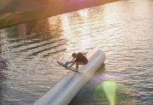 Wakeboarder Angelika Schriber hitting the sunset rails in California