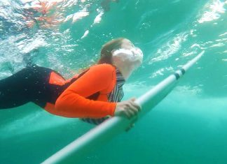 Surfer duck diving under water in Glide Soul wetsuit