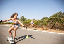 Girl surf training on land with surf skate