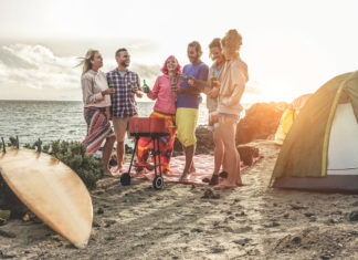 Surfers camping on the beach
