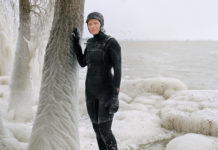 Woman in wetsuit in snow