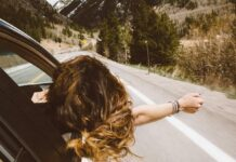 road trip girl hanging out car